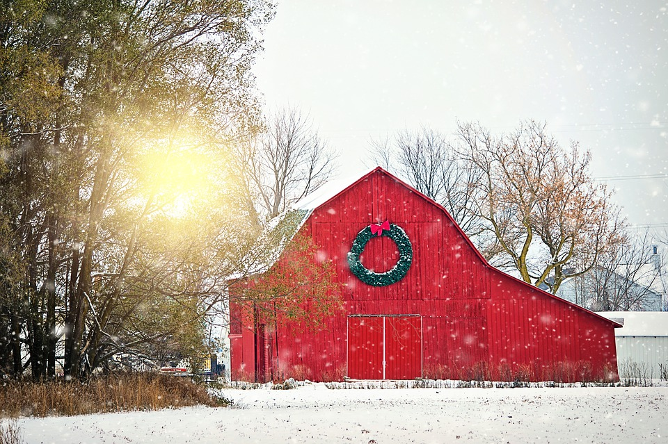 Red barn with a Christmas wreath